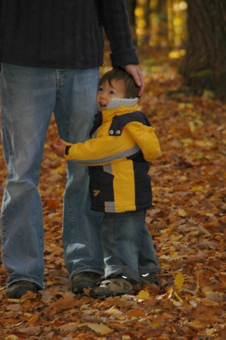 D hugging his dad's leg