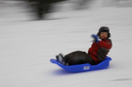 D speeding by on sled