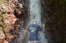 Matt with head in waterfall, Rainmaker