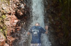 Matt with head in waterfall, Rainmaker