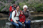 smiling family at blue pool, Glengarrif