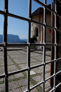 bled castle through barred grate