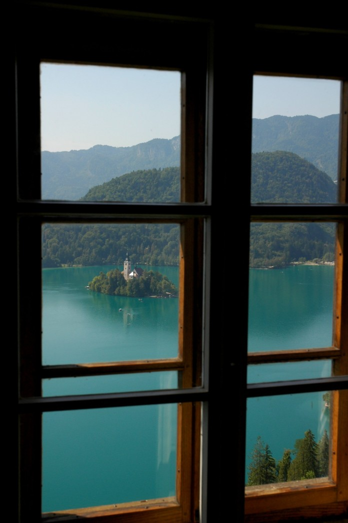 Bled church and island from closed window of castle