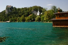 Lake Bled with castle, church, and boathouse