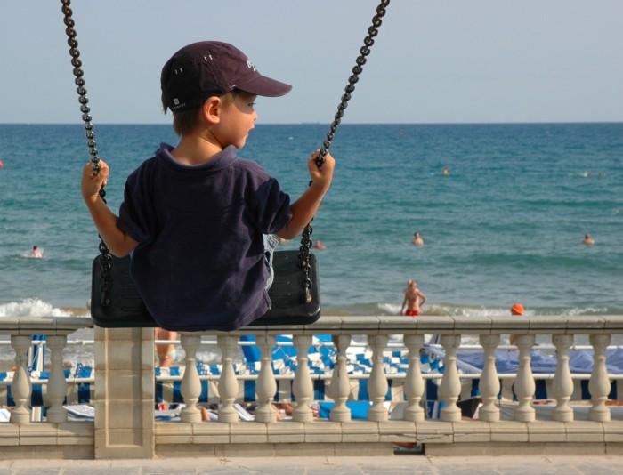 G on swing on beach
