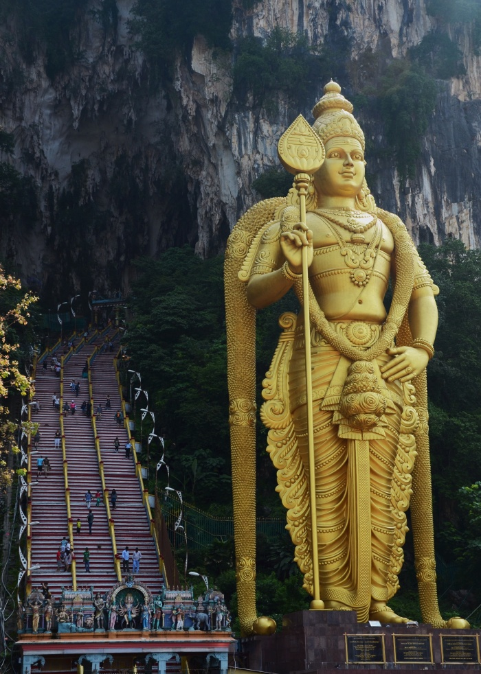 Statue of Lord Murugan standing 42.7 meters high at the base of 276 steps up to Batu Caves, Kuala Lumpur.