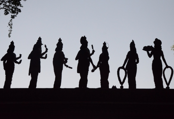Temple figures in silhouette