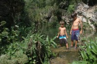 boys at edge of pool in gorge
