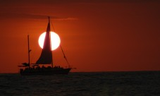 sunset with sailboat closeup