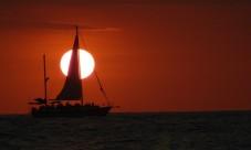 sunset with sailboat closeup