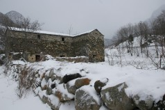 stone house in snow